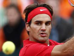 Roger Federer of Switzerland, shown here in his singles match Friday, lost in doubles with Stanislas Wawrinka on Saturday.