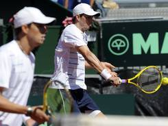 Mike, right, and Bob Bryan of the USA defeat Marcel Granollers and Marc Lopez in doubles Saturday to narrow Spain's lead in the Davis Cup match to 2-1.