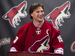 Shane Doan will continue to wear his Coyotes captain's jersey after re-signing with the team on Friday.