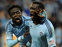 Sporting KC forward C.J. Sapong, right, celebrates with teammate Kei Kamara after his goal in stoppage time, which earned his team a 1-1 draw.