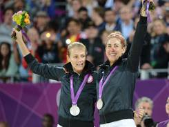 Olympic silver medalists  Jennifer Kessy and April Ross celebrate on the podium at the London Olympics on Aug. 8.