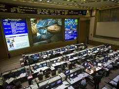 U.S. astronaut Joe Acaba can be seen on the big screen at Russian Mission Control Center in Korolev. Acaba is back on Earth after four months at the International Space Station.