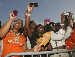 Florida A&M students listen as hip-hop artist Future performs during halftime of an NCAA college football game between Florida A&M and Hampton on Saturday.