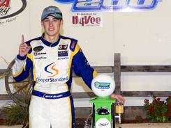 Ryan Blaney, poses with a gasoline pump trophy after winning the American Ethanol 200 Saturday night at Iowa Speedway.