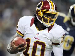 Washington quarterback Robert Griffin III was banged around much of the day by the Rams, too much according to Redskins coach Mike Shanahan.