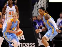 Sky guard Courtney Vandersloot, left, and forward Tamera Young prepare to run a fast break during their rout of the Mercury.