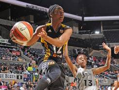 Guard Ivory Latta, driving past Silver Stars guard Danielle Robinson, scored 15 points and added four assists in the Shock's 80-70 win.