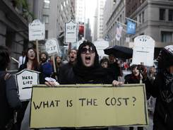 Protesters chant during an Occupy Wall Street march, Monday, in New York.