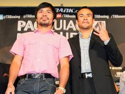 Manny Pacquiao and Juan Manuel Marquez, pictured in Beverly Hills on Monday, have fiught three times and will go around a fourth time on Dec. 8