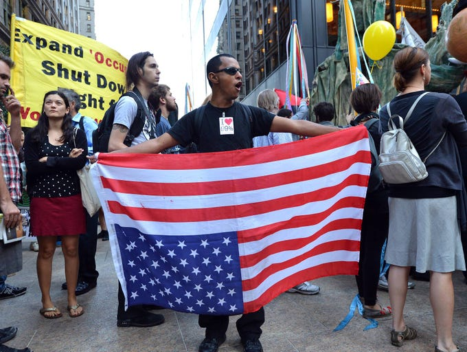 Protesters demonstrate near Wall Street in New York City.  It has been one year since the movement staged its first demonstration, and protesters plan various actions and events throughout the day.