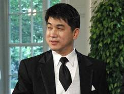 "In this May 19, 2010, file photo, Olympic speedskating coach Jae Su Chun arrives for a State Dinner for Mexican President Felipe Calderon at the White House in Washington.  Current and former members of the U.S. speedskating team filed complaints accusing head coach Jae Su Chun of ""unchecked"" verbal, physical and psychological abuse."