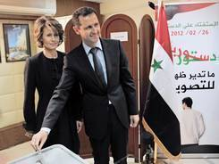 Syrian President Bashar Assad, with wife Asma, casts his ballot Feb. 26 at a polling station in Damascus.