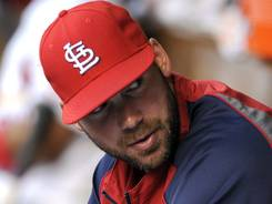 Cardinals' Chris Carpenter hasn't thrown a pitch all season because of thoracic outlet syndrome.