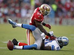 49ers inside linebacker NaVorro Bowman (53) tackles Detroit Lions wide receiver Calvin Johnson (81) after Johnson was unable to make a catch Sunday night.