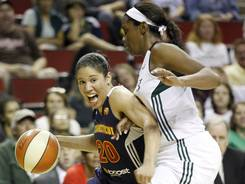 Sun guard Kara Lawson, left, driving past Storm forward Shekinna Stricklen, tallied 13 points and five rebounds to lead Connecticut to a 60-58 victory.