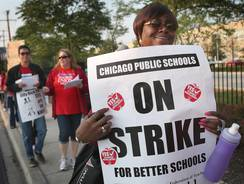 Teachers picket outside George Westinghouse College Prep High School.