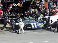 Denny Hamlin comes in for service during the Geico 400 at Chicagoland Speedway.