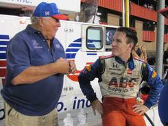 Owner A.J. Foyt, left, talks with driver Wade Cunningham after his 17th-place finish Sunday in the MAVTV 500 IndyCar race.