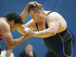 In this file photo from Jan. 28, 2012,  Rulon Gardner (right) grapples with India's Pal Rishi during their 120-kilogram match at the Kiki Cup wrestling competition  in Colorado Springs, Colo.