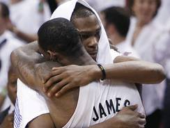 Oklahoma City Thunder forward Kevin Durant (with the towel) embraces Miami Heat  forward LeBron James after the Heat won the NBA championship in June.