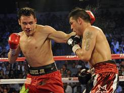 Julio Cesar Chavez Jr., left, not only lost to to Sergio Martinez, but also tested positive for marijuana.
