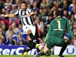 Juventus' Italian striker Fabio Quagliarella (L) scores their second goal during their UEFA Champions League group E football match against Chelsea.