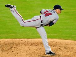 Braves starter Kris Medlen throws during the fourth inning Wednesday vs. the Marlins.