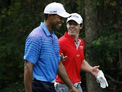 Tiger Woods (left) and Rory McIlroy, sharing a laugh at the BMW Championship, are the top two in the world rankings and the FedExCup standings. McIlroy is first in both.