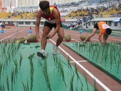 Competitors race Thursday to plant rice seedlings in an event at China's National Peasants' Games, which ends Saturday in Nanyang, central Henan province.