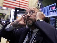 Trader Frederick Reimer works on the floor of the New York Stock Exchange on Thursday.