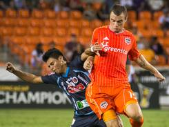 Houston Dynamo forward Cam Weaver, right, vies for the ball against FAS defender Alexander Larin. Houston won 4-0 and improved to 2-0-1.
