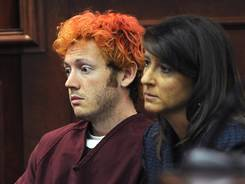 In this July 23 photo, James Holmes appears in Arapahoe County District Court with defense attorney Tamara Brady in Centennial, Colo.