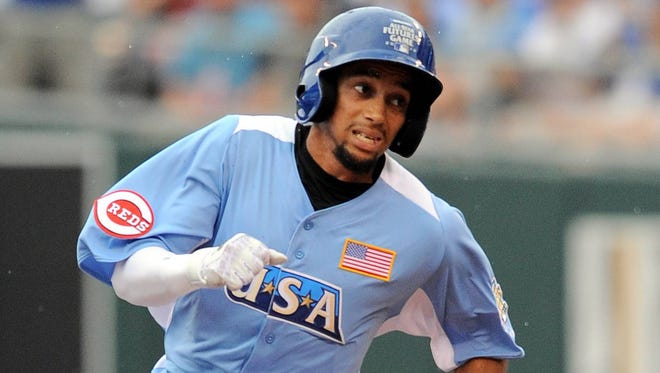 Reds shortstop prospect Billy Hamilton, shown here at the All-Star Futures Game in Kansas City, set the professional baseball record with 155 stolen bases this season.