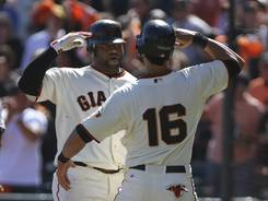Pablo Sandoval and Angel Pagan celebrate Sandoval's three-run homer.