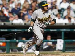 Athletics left fielder Seth Smith hits an three RBI double during the ninth inning against the Tigers to break the game open.
