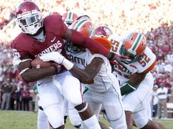 Oklahoma running back Damien Williams scores a touchdown against Florida A&M. The Sooners face a tougher test when No. 13 Kansas State visits.