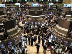 Specialists and Traders work the trading floor at the New York Stock Exchange in this file photo.