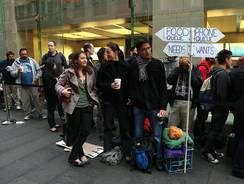 Customers wait in line Friday to purchase the iPhone 5 at an Apple store in Sydney, Australia.