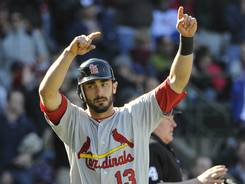 Cardinals infielder Matt Carpenter scores the winning run in the 10th inning Saturday against the Cubs.