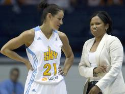 Point guard Ticha Penicheiro, left, with Sky coach Pokey Chatman, played the 454th and final game of her WNBA career. She is the league's all-time assist leader with 2,599.