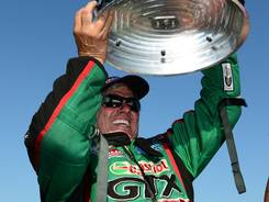 NHRA Funny Car driver John Force celebrates after winning the Traxxas Shootout during qualifying for the Fall Nationals at the Texas Motorplex.