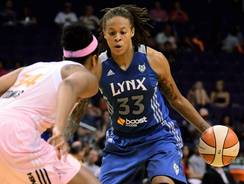 Lynx guard Seimone Augustus drives on Mercury center Krystal Thomas during the Lynx's 89-66 win Friday.