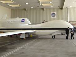 A NASA Global Hawk robotic jet sits in a hangar at Dryden Flight Research Center in Edwards Air Force Base, Calif.