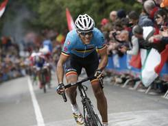 New world champion Philippe Gilbert of Belgium breaks away on Cauberg hill during the men's road race of the world championships over 267 kilometers (166.9 miles) in Valkenburg, southern Netherlands, Sunday.