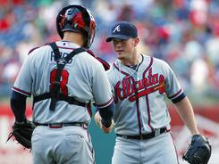 Closer Craig Kimbrel is congratulated by catcher David Ross after the Braves defeated the Phillies.