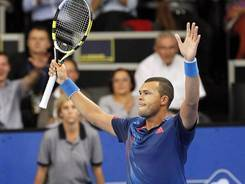 Jo-Wilfried Tsonga of France raises his arms in victory after defeating Andrea Seppi of Italy at the ATP Moselle Open.