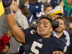 Notre Dame linebacker Manti Te'o had two interceptions as the Irish held Michigan without a touchdown for the first time in 29 meetings in dating to 1943.