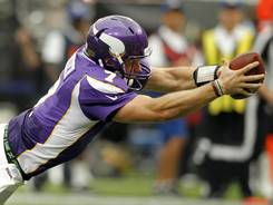 Vikings QB Christian Ponder extends to complete a 23-yard TD run Sunday.