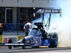 Antron Brown outdragged Spencer Massey in the Top Fuel final.