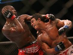 Jon Jones (left) fights Vitor Belfort in the light heavyweight championship during UFC 152 at the Air Canada Centre in Toronto on Saturday.